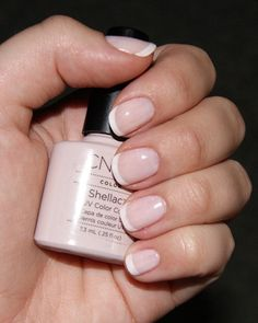 White nail polish with base coat, 2 coats Shellac CND Romantique & top coat