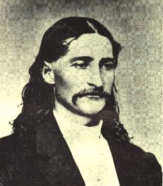 """(1837-76) Born in Troy Grove, near Ottawa, Illinois, James Butler """"Wild Bill"""" Hickok took part in the Kansas struggle preceding the Civil War, was a driver of the Butterfield stage line, and gained fame as a gunfighter. He served as a Union scout in the Civil War and afterwards became deputy United States Marshal at Fort Riley (1866), Marshal of Hays, Kansas (1869), and Marshal of Abilene (1871). His reputation as a marksman in desperate encounters with outlaws made him a frontier legend."""