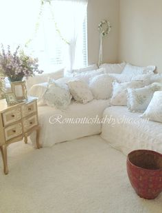 Two twin beds pushed together in corner, piled with pillows. *Must take a look at the blog to see the whole room for full effect.