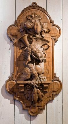 A Pair of Swiss Black Forest Wall Plaques