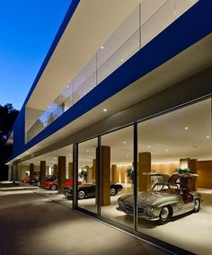 Home built to show off a car collection; we're in love with all this glass! | The Glass Pavilion by Steve Hermann