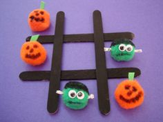 Homemade Halloween Tic Tac Toe. Love this because it's a craft AND an activity!