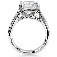 Trellis Solitaire Engagement Ring: This hand crafted engagement ring is the perfect mounting for round, princess cut or square-cut diamond.  Its' fluid design creates a classic yet contemporary look. Available in all sizes and metals.  Please call for details. The center  diamond is not included in the quoted price.
