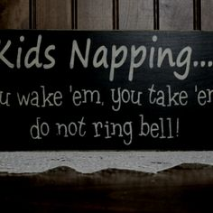 """A must for parents with light sleepers! Sorry it's not a good photo, it says """"Kids napping. U wake em', you take em', do not ring the door bell!"""""""