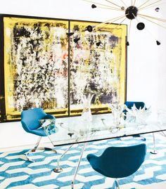 Modern and artful dining space with blue chairs