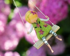 Girl in a green dress with violet flowers on a swing, needle felted doll, possible other colors