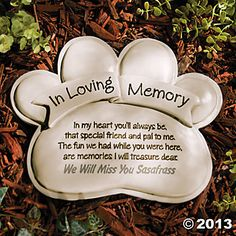 "Paw Print Memorial Stone - Paw Print Memorial Stone. Set it in a garden to remember a cherished pet. Personalize with 1 line of 26 characters/spaces. Resin. 9"" long x 11"" wide. ($14.00)"