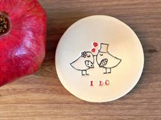 Little Bird plate for your wedding with text I DO. The birds silhouette is elegant black and red color and shiny, transparent clear glaze. A small
