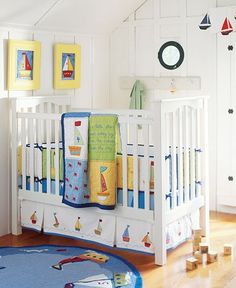 Sailboats and fish under a blue sky help create this nautical-themed nursery.