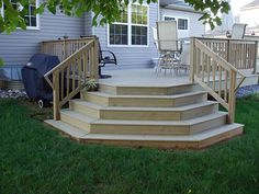 Pressure treated wood desck with waterfall steps. Pressure treated wood desck with waterfall steps. Pressure treated wood desck with waterfall steps. Pressure treated wood desck with waterfall steps. Front Porch Steps, Deck Steps, Front Deck, Low Deck, Patio Stairs, Outdoor Stairs, Backyard Patio, Deck With Stairs, Patio Decks