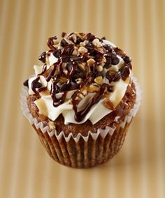 Gigi's Cupcakes - Kentucky Bourbon Pie: Bourbon cake with pecans and chocolate chips, a cream cheese frosting with pecans and chocolate chips drizzled in caramel and ganache´.