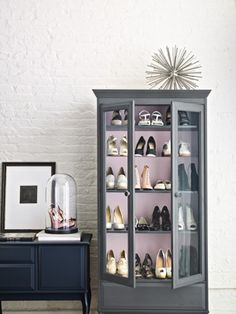 Create a boutique-like atmosphere by arranging your shoes in a glass-doored hutch. To figure out how many shoes the cabinet can hold, assume each pair takes up about eight inches across—then do the math. If you need more space, hit up a home-supply store, which can easily cut shelves for you. Don't forget to pick up spare pegs (bring existing ones with you so you can match the size) to place them on. Bell Jar: What was historically used for laboratory experiments is now a dramatic display…