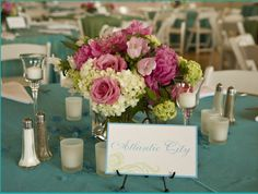 Flowers by Stoneblossom Florals and table names by New England Invitations
