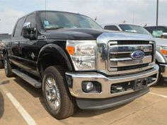 2013 Ford F-250SuperDuty Lariat 4x4 Lariat 4dr Crew Cab 6.8 ft. SB Pickup Pickup 4 Doors Kodiak Brown Metallic for sale in Katy, TX Source: http://www.usedcarsgroup.com/new-ford-f_250_super_duty-for-sale