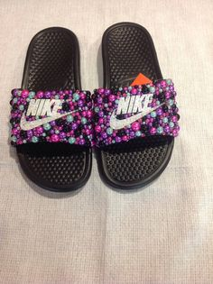 Check out this item in my Etsy shop https://www.etsy.com/listing/278377734/bling-nike-slides-nike-shoes-swarovski