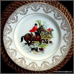 Well sought after collectible set of English fine bone china hand-painted dinner plates set with equestrian, foxhunting English countryside scenes with exquisite refined lace filigree pattern of real 24 karat gold set against the plates wide rims. Absolutely stunning collectible set to add to your existing equestrian themed collection of English bone china. Absolute showstopper and breathtaking design. #Equestrian #Foxhunting #Englishbonechina #dinnerplates #collectiblechina