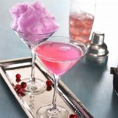 cotton candy martini | 2 ounces of vodka 1 ounce of cranberry juice 1 ounce of pineapple juice a bag of cotton candy | combine the vodka and juices over ice in a cocktail shaker, shake it vigorously for 10-15 seconds then pour it over the puff of cotton candy patiently waiting in the martini glass to be doused and dissolved.