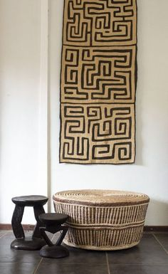 African Contemporary sourced this woven table and wooden stools from Zimbabwe an. African Contemporary sourced this woven table and wooden stools from Zimbabwe and the Kuba cloth fr