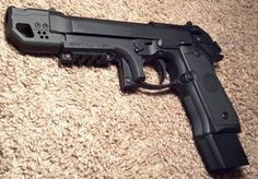 Berretta 9mm customized with mag extension