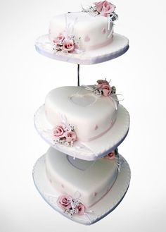THREE TIER HEART SHAPE WEDDING CAKE.  THIS DARLING WEDDING CAKE WITH ITS CENTRE HEARTS AND BEAUTIFUL SUBTLE FLOWERS WILL BE STUNNING AT ANY STYLE WEDDING.