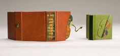 The Art of Practicing the Cello by R. Wu. Modern oriental binding. Full goat skin green leather with darker green goat skin on the spine. Onlays of lacunose leather. Music endpapers Box: full goat skin leather, music paper lining, lacunose onlays. Title on the spine over lacunose.