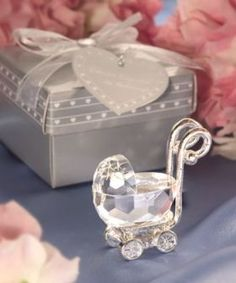 """Prepare for your baby to ride in style with these Choice Crystal baby carriage favors. Whether it's for baby shower favors, christening favors, or a unique way to distinctively announce your baby's arrival, these crystal baby carriages really rock! From the exclusive Choice Crystal line, each brilliant favor is approximately 2"""" and features a skillfully faceted crystal carriage with accenting chrome embossed metal handle and wheels."""