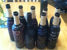 Have people sign a champaign or beer bottle at house warming party ((creatief-met-flessen))