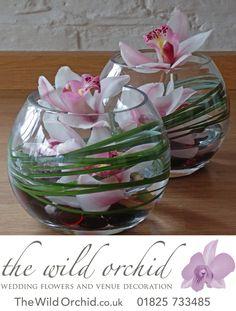 Mini fishbowls filled with pink cymbidium orchids and bear grass. A row of these along a top table make great centrepieces.