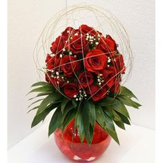 BELOVED  Its a bouquet for your dearly beloved.  30 gorgeous red #roses caged in a slim gold wire criss-crossed like valentine emotions.  A glass vase with red water bring the warmth of this beautiful display of roses right across the home.  This product delivers only in MUMBAI VASHI THANE