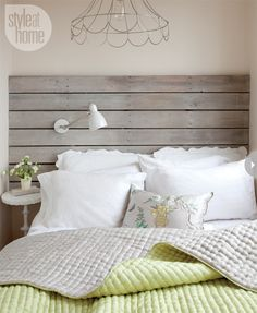 A pendant light with a delicate naked lampshade adds interest without over-whelming the tiny bedroom or stealing the homemade headboard's limelight.
