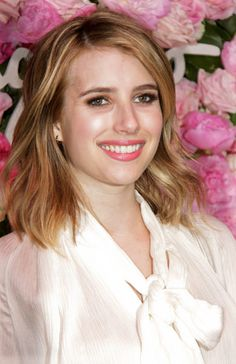 """Highlights and lowlights are a great way to add body to fine hair,"" says Scott Fontana, owner of Cristophe Salon Newport Beach. ""Emma Roberts gets highlights to brighten her hair as well as giving her hair tons of lift and volume."""
