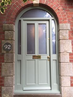 Beautiful external doors with cockbead details all around. Finished with Farrow & Ball 'Lichen' Arched Doors, House Front, House Exterior, External Doors, Entry Doors, Green Front Doors, Red House Exterior, Front Door Porch, Doors