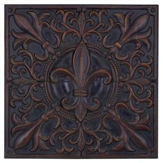 A charming addition to your foyer or living room, this delightful metal wall decor showcases a fleur-de-lis motif and dark brown finish.