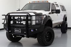 "2014 Ford Super-Duty F-350 SRW King Ranch 4X4 •8"" Pro Comp Suspension Lift Kit •37"" Toyo Open Country MT Tires •20"" Black Fuel Wheels •Amp Powered Running Boards •Black Fender Flares •ARE Paint Matched Locking Camper Top •Front Metal Bumper Guard •Custom F-350 Side Lights •Aftermaket Headlamps •Power Sliding Moonroof •Heated & Cooled Front Seats •Heated Rear Seats •White Platinum Metallic Tri-Coat Exterior •Roof Clearance Lights •Husky Liner Floor Mats •6.7L Power Stroke Turbo Diesel V8…"