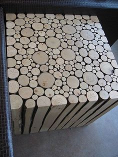 So this pic makes me think about modifying this idea by using inexpensive square dowels on the outside and circle dowels within that to construct  end tables.