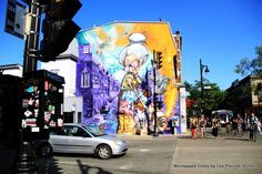 20 street artists from allover the world invited by the MURAL street art festival to create murals on Saint-Laurent Boulevard in Montreal.
