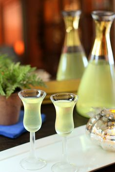 Homemade Limoncello:  12 organic lemons  1.75 liter bottle of 100-proof vodka, divided  2 cups water  2 cups sugar