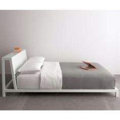 This is my supah cool bed from cb2.com. The headboard is slanted for easy reading and sitting up in bed and there is an useful wide edge on the back. You can put books, reading lamp or alarm clock on top.