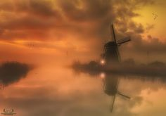 The Lost Mills - There was a lot of thick mist during my latest trip to Kinderdijk. After about one and a half hour it slowly disappeared after sunrise. I took 3 shots in that period of time, the first one while I could hardly see a thing, the second when the closest windmill started to show up and the last one when the other mills slowly became visible. Of course my gear was not moved during that time. In post I blended these 3 images and this was the final result...........