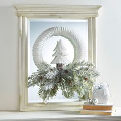 Give the traditional wreath a modern twist with this magical makeover when you make the Cozy Lodge FloraCraft® Holiday Wreath