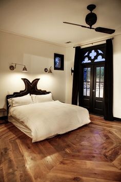 FLOOR!!  Bouldin Castle - Amazing bedroom with polished nickel swing-arm sconces highlighting ...