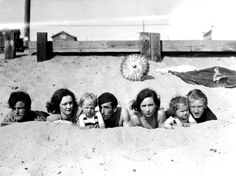 A young Marilyn Monroe with her mother at the beach. Norma (third from left) on the beach as a toddler with her mother (second from left) Gladys Baker, and a group of friends.