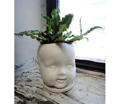 Porcelain doll head planter