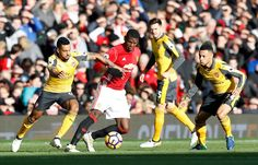 Paul Pogba and Theo Walcott battle for the ball