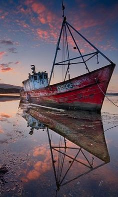 An old fishing boat (Sabrina) left to decay in Milford (Mulroy Bay) County Donegal, Ireland.