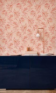 pink wallpaper + navy credenza