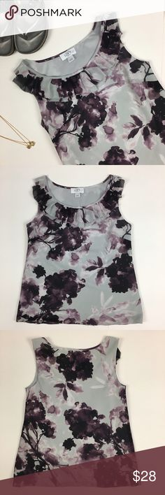 Gray and purple floral loft tank Gray and purple floral loft tank. Ruffle at the neckline. Loft size XXSP, definitely not as small as it seems, since it fits the mannequin well. Shell and lining 100% polyester. Small run shown in last picture. LOFT Tops Tank Tops