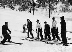 A young JFK (center) and family take ski lessons in Switzerland, January 1939.  10 Photos of Kennedys Playing in the Snow  - TownandCountryMag.com