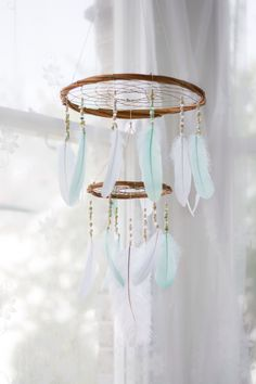 Mint and White Feather Mobile Chandelier - Bohemian Nursery Mobile Nursery Hanging Decoration Baby Shower Gift Handmade Dreamcatcher Mobile by HippiebyViki on Etsy https://www.etsy.com/listing/387189600/mint-and-white-feather-mobile-chandelier