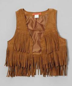 A trendy treat for the fashion-forward girl, this vest flaunts cowboy-cool fringe. Soft faux suede construction makes this layering piece as comfy as it is bold.